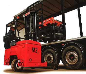 A red electric Moffett truck mounted forklift offloading equipment from a lorry in Glasgow, Scotland